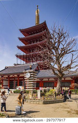 25 March 2019: Tokyo, Japan - The Five-storey Pagoda And Clocktower At Senso-ji Buddhist Temple, Tok