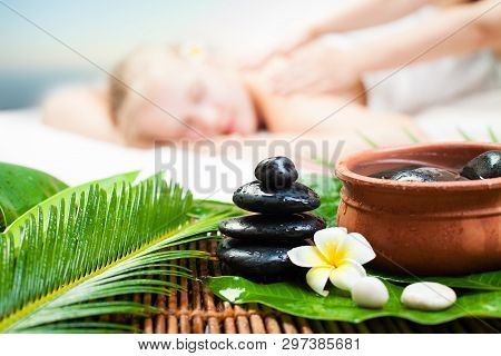 Spa Massage Outdoor. Beautiful Young Woman Getting Spa Massage. Focus On Spa Object