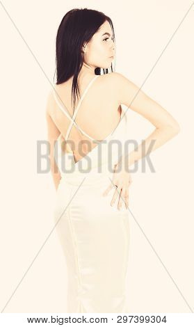 Fashion Wedding Concept. Woman In Elegant White Dress With Nude Back, White Background. Fashion Mode