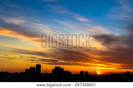 City Skyline, Silhouettes Of Buidings Against Dramatic Sky In Sunset, Dawn, Late Evening Hours. City