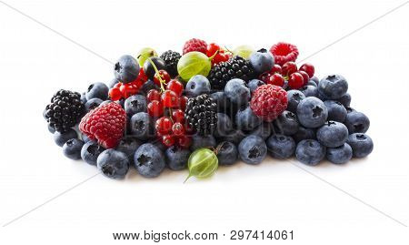 Berries Isolated On White Background. Ripe Blueberries, Blackberries, Blackcurrants, Raspberries, Go