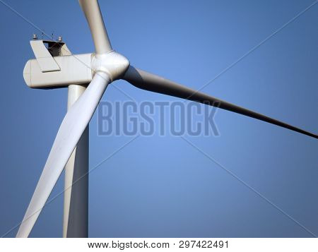 Wind farm generator tower and rotor blades assembly. poster