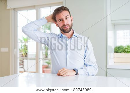 Handsome business man confuse and wonder about question. Uncertain with doubt, thinking with hand on head. Pensive concept.