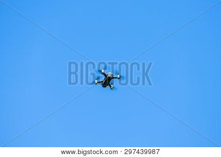 An image of a toy drone blue sky background