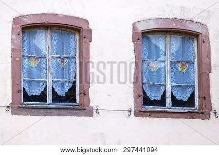 An image of two vintage windows in Thann France