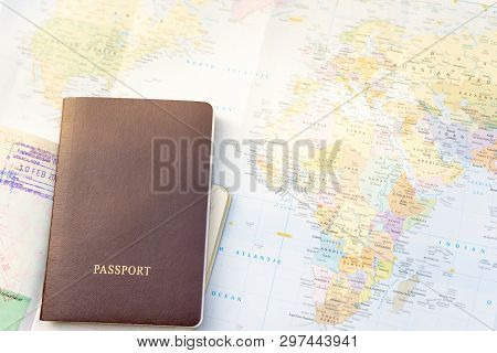 Passport On A Map Of The World. Globe Map On A Background.departure And Arrival Stamp On The Page Of