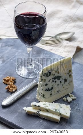 Piece Of French Blue Cheese Roquefort, Made From Sheep Milk In Caves Of Roquefort-sur-soulzon And Gl
