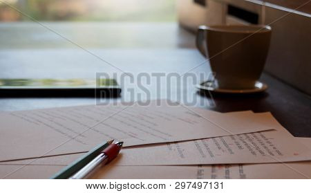 Proofreading Paper On Table With Writing Hand