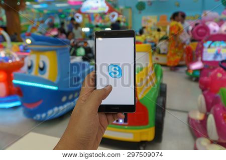 Chiang Mai, Thailand - Jan. 06,2019: Man Holding Huawei With Skype Apps. Skype Is Part Of Microsoft,