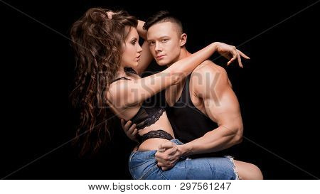 Sexy Young Couple. Sensual Woman With Straight Body In Lace Erotic Lingerie Sitting Above Muscular M