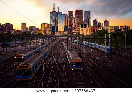 Melbourne Train Staation With Melbourne City Background In Sunset, Australia, This Immage Can Use Fo