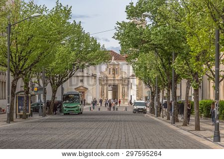 Coimbra / Portugal - 04 04 2019 : View Of A Plaza, With Iron Gate Of The University Of Coimbra, Clas