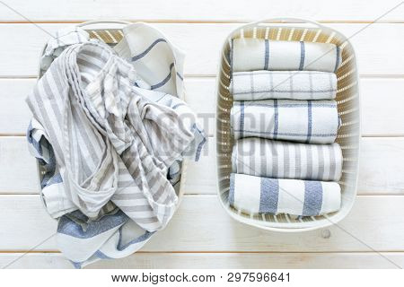 Marie Kondo Tidying Concept - Folded Kitchen Linens In White Basket, Top View