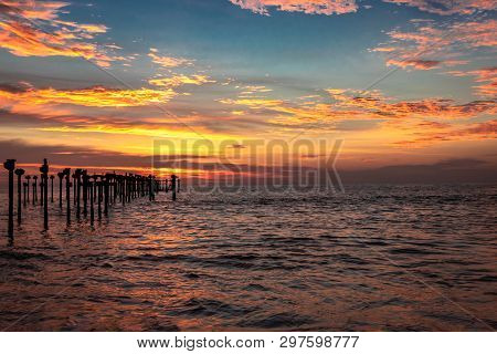 Orange Cloud Sunset View Above Sea Surface And Iron Pols At Alleppey Beach India. Cloud Image In Sun