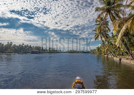 Sea Backwater At Alleppey Kerala With Palm Tree And Boat Front Edge Giving Wide Look Of Beautiful Na