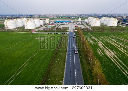 Aerial View On Refineries Oil Big Tanks And Train Transfering Station.