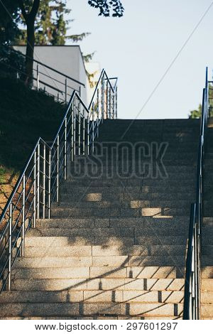 Empty Concrete Stairs With Stainless Steel Handrails.