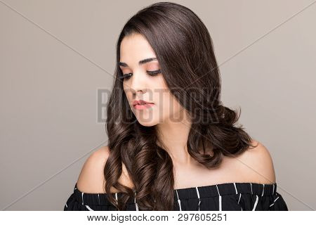 Good Looking Woman With Long Luscious Hair Wearing Off Shoulders