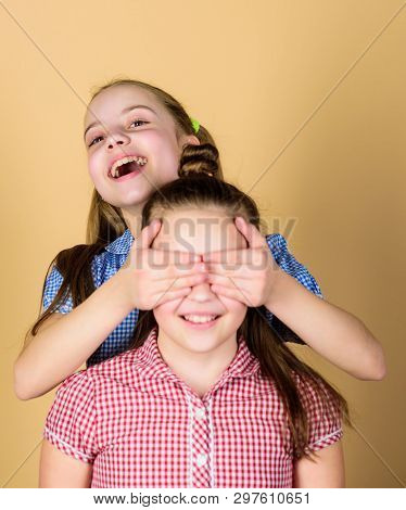 Guess Who. Playful Little Girl Covering Eyes Of Her Cheerful Sister And Smiling. Cute Children Happy
