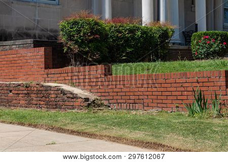 Old Brick Retaining Wall In Front Of Newer Red Brick Retaining Wall, Horizontal Aspect