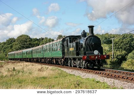 Drummond M7 Steam Locomotive No. 53 Approaches Corfe Castle On The Swanage Railway - Corfe Castle, D