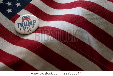 Selinsgrove, Pa - April 11, 2019 : Trump-pence 2020 Pin Badge Shot Over United States Of America Fla