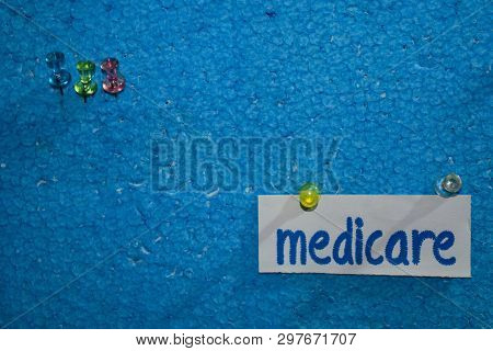 Medicare text on the paper is attached to the styrofoam with push pins, Health care concept as a schedule reminders poster