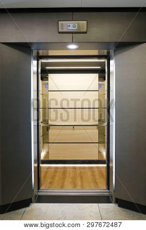 Modern Elevator With Doors Open In Office Building