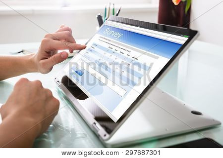 Businessperson Filling Online Survey Form On Digital Laptop