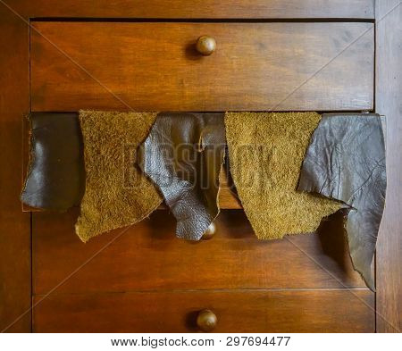 Sample pieces of leather in wooden drawer. Natural leather upholstery samples poster