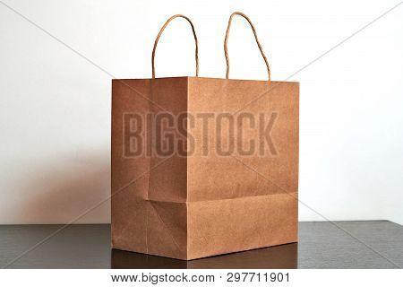 Luxury paper shopping bag on black dresser poster