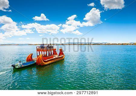 Titicaca Lake, Puno, Peru - March, 20, 2017. Traditional Totora Boat With Tourists On Titicaca Lake