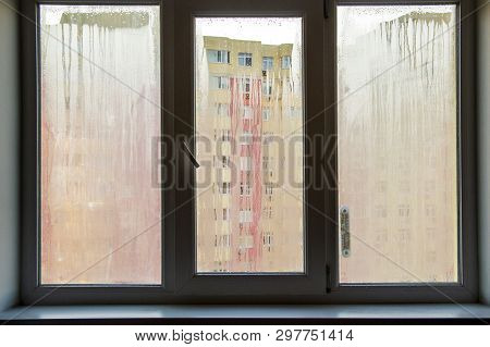 The problem - plastic windows mist over, background poster