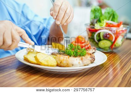Asian Senior Or Elderly Old Lady Woman Patient Eating Breakfast Healthy Food With Hope And Happy Whi