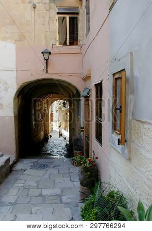 Cobble Stones And Ancient Passage Ways Greet Visitors To The Island Of Malta.