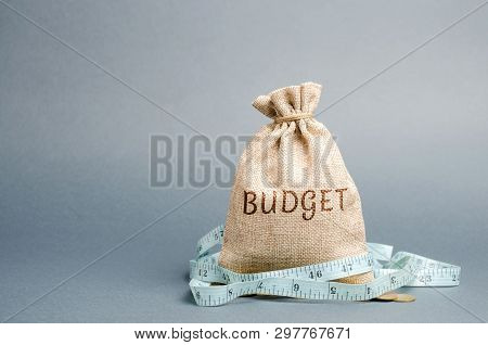 Bag With Money And Tape Measure And The Word Budget. Limited Budget. Lack Of Money. The Concept Of A