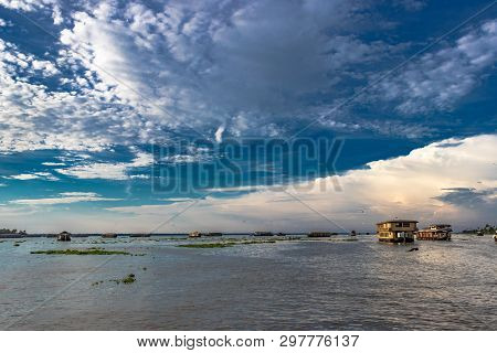Amazing Sky View Above Backwater Of Alleppey Kerala India With White Cloud, Blue Sky And Houseboats.