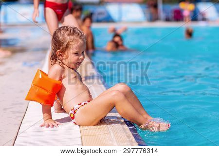 Girl Learning To Swim. Little Kids In Swimming Pool.