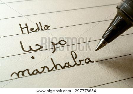 Beginner Arabic Language Learner Writing Hello Word Marhaba In Abjad Arabic Alphabet On A Notebook C
