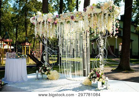 Flower Wedding Arch For The Ceremony. Arch For The Wedding Ceremony, Decorated With Flowers
