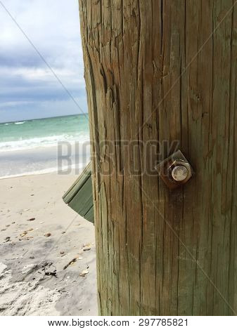 Panama City Beach From Under The Pier, Green And Blue Water By A Wood Pier Pole