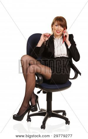 Young Smiling Business Woman Sitting In Office Chair