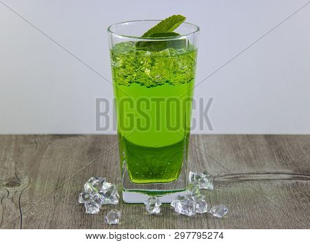 A Glass Of Nutritious Estragon Drink To Maintain A Healthy Lifestyle. Were Added To The Drink Ice.