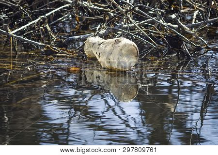 Water Pollution, Empty Plastic Bottles. Plastic Bottle By The River.