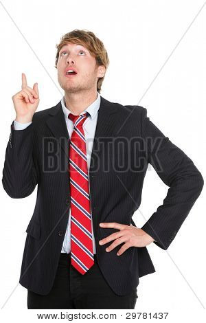 Businessman having an idea - eureka. Thinking young business man pointing up in suit isolated on white background.