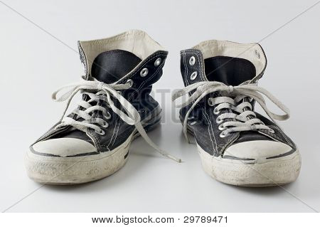 Black color vintage sneakers.