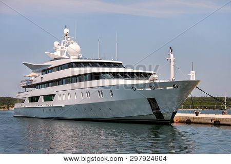 Large Modern Luxury White Yacht And Ship Anchored In Harbor. Large White Modern Motorboat Super Yach