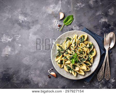 Conchiglioni Pasta With Spinach In Creamy Sauce. Top View