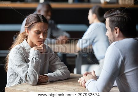 Shy Or Bored Woman Sitting With Man On Speed Dating