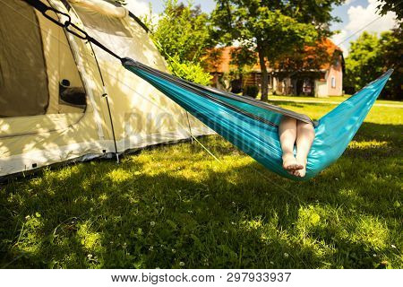 Little Girl In The Hammock And The Tent In Background